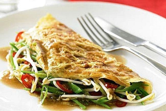 Omelettes with fresh vegetables and sprouts