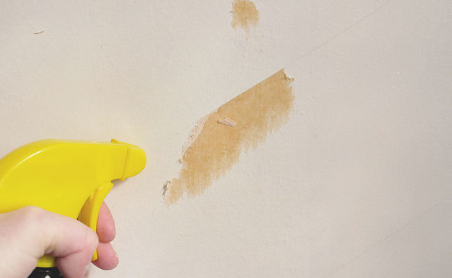 Spraying hard to remove remnants with warm water or remover solvents can help to prevent damaging the wall surface